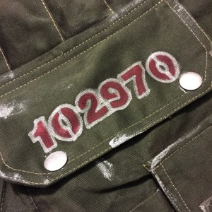Here's my serial number inscribed on a pocket flap.